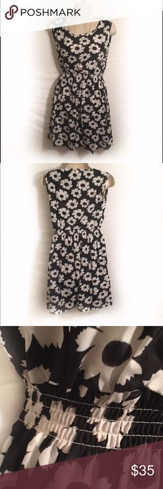 Black & White Sundress Black & white Sundress. Brand new in package. Does not come with tags. Elastic waist. Size M. Liva Girl. Liva Girl Dresses Midi