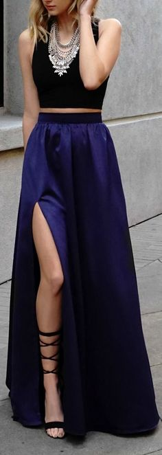 Long blue skirt with a simple black top and a statement necklace make the perfect look for a night event where you wanna stand out. Fashion Trend.