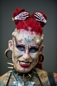 Maria Jose Cristerna (or Marijose) from Guadalajara Mexico, she cover her body in tattoos, piercings, titanium implants and dental fangs to re-invent herself as a vampire