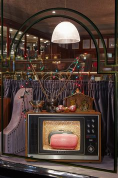 Anya Hindmarch Bespoke, Pont Street:   Vintage television sets, retro decorations and Seventies board games evoke memories of Christmas past.