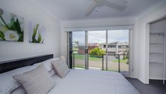 Executive Townhouses | Family Friendly Accommodation - Escape At Nobby's Washing Machine In Kitchen, Iphone Docking Station, Electric Bbq, Living Area, Living Room, Holiday Accommodation, Us Beaches, Two Bedroom, Queen Beds