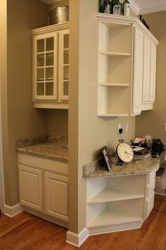 Corner shelves and an angled counter top just look so much better than the broad side of a cabinet.