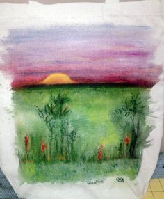My first experiment with Derwent Inktense Blocks on a canvas tote. These are a lot of fun to use!!!