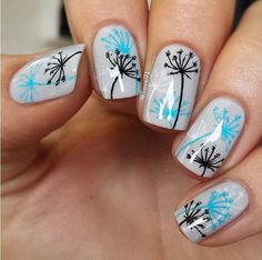 Be different and paint your nails with blue gray base color. The Dandelions are drawn in blue, black and white hues to perfectly blend with the background and at the same time compliment each other's hues.