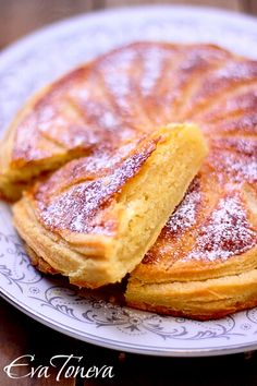 Gateau Pithiviers....is a round, enclosed pie usually made by baking two disks of puff pastry, with filling stuffed in between and this one has almonds stuffed in between