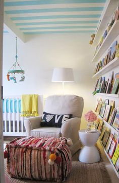 Like everything about this-a wall of books, comfort, wonderful ottoman,  the pillow and the color on the ceiling.