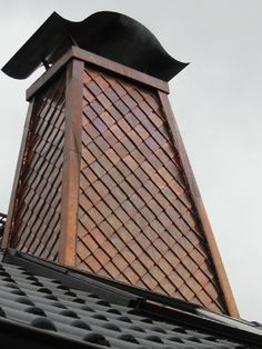 Copper shingle chimney in Germany. http://copperexclusive.com/portfolio-2/european-projects/