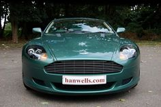 2005-54 Aston Martin DB9 Auto/Manual. Finished in special order Aston Martin Racing Green. Just fitted with new tyres all round and the interior, finished in Cotswold, is complemented with Racing Green secondary hide and carpets, with Walnut veneers. It has only covered 13,100 miles. All old MOTs and 5 services. This car is like new £49.999 Full Details:   http://hanwells.net/prestige-select/aston-martin/2005-54-aston-martin-db9-in-aston-martin-racing-green-49-999