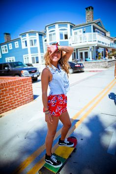 Bright Hawaiian patterned shorts plain denim crop top with black hightops great simple outfit for the Summer