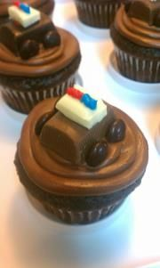 Devil's food cupcake with chocolate frosting and Hershey's Nugget police car!