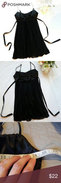 Black accordian style cocktail dress In perfect condition! Like new. Gorgeous black strap dress. Has adjustable straps. Satin feel top. Very flowy. 100 % polyester. Has little black beads under the bust. Ties in the back. Bust and length Measurements provided in pics above. From Macy's. From a smoke and pet free home. Fast shipping! Office - Vacation - Wedding - Fun - Dress up - prom - date night - cruise - spring - summer *IF YOU LIKE MY ITEMS, please FOLLOW ME to see NEW ARRIVALS that are…