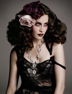 Laetitia wears jumpsuit Chanel. Bra Bordelle. Necklace David Morris. Flowers Legeron.