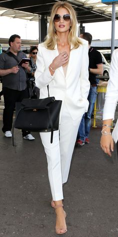 ROSIE HUNTINGTON-WHITELEY The model was off to a stylish start when she landed in Nice in a fresh Magda Butrym tailored suit, complete with round Jimmy Choo shades, a delicate Anita Ko lariat, a sleek black holdall, and nude Jimmy Choo sandals.