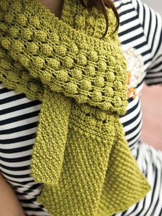 Slightly shorter than the usual scarf, knit this textured piece in a fun color to brighten basic outfits.
