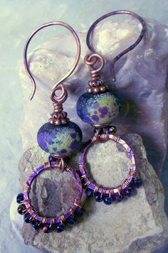 Twilight Diadem:  Rustic violet glass lampwork beads, violet-patinated copper circles wrapped in tiny purple iris Czech glass beads--by TwoTreesStudio on Etsy ($34).