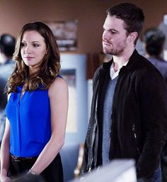 """Katie Cassidy & Stephen Amell as Laurel Lance and Oliver Queen on The CW's """"Arrow"""""""