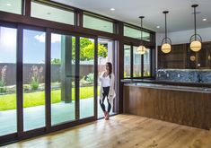 Gotta love a pocketing multi-slide door creating an open space in this kitchen! Indoor Outdoor Living, Outdoor Spaces, Sliding Patio Doors, Resort Style, Luxury Living, Luxury Homes, Building A House, New Homes, Windows