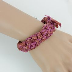 Pink vintage Sari silk, hand crocheted to create a one piece bangle bracelet measuring 7 (18 cm). Sewn into the raw edged bow of this pink bracelet is the charm of a silver plated dragonfly. A loose fitting boho chic bangle, soft silk with silk sewn edges. It looks great alone or stacked with silver, wood, leather, or other silk bangles (see photos for bracelet stacked with other silk bracelets).  Hand wash gently in cool water and air dry. Please contact me if you have any questions about…