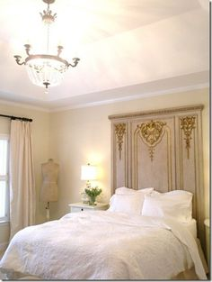 bedroomw ith painted and gilded panel headbaord via pinterest