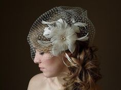 short veil with flower/feathers - I was too traditional to wear this at my wedding, but I would have LOVED to!!
