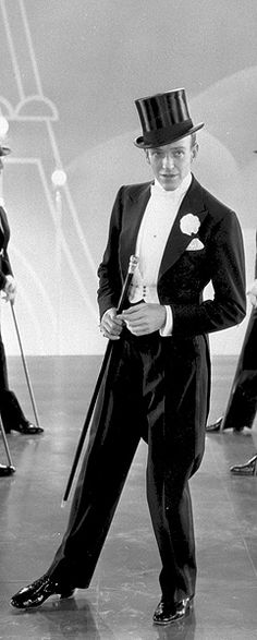 """Fred Astaire, said by many to have been THE most stylishly dressed man ever, wearing THE most elegant of togs for males: the full dress tails and white tie (bow)--some still say that, notwithstanding the era of sweats, jeans, and """"tennis shoes."""""""