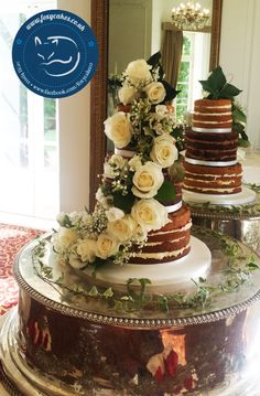 A Beautiful Naked Cake decorated with fresh flowers, made by The Foxy Cake Co!