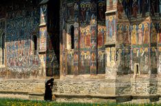 """""""Holy approval""""  An crowd of holy men looks down approvingly on the mean work of a nun at the choir of Moldovita's monastery church, Romania. The frescoes were done in 1537 by Toma of Suceava. Photo Mick Palarczyk."""