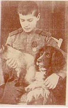 Alexei with his Spaniel Joy and Silina, the Siamese Cat of his sister Marie