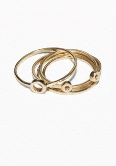 Symbolic and intriguing, these rings form dainty circles and are made from polished brass.