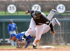 TAKING ADVANTAGE:    Rymer Liriano of the The Chicago White Sox steals second on a throwing error by Kansas City Royals pitcher Jason Hammel, advancing to third as Royals shortstop Ramon Torres hits the dirt in the fifth inning in Glendale, Ariz., on March 15. Chicago won 7-3.