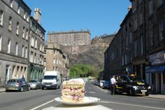 """Go to the junction of Bread Street & Spittal Street in Edinburgh at dusk. Beside the shop on the corner is a blue door. Stand by that door and look up towards the castle. This is the view A man called George Gibson had, who was born a few feet from you, behind that blue door, emigrated to the US in 1930, worked as a scenic artist in the MGM movie studio between 1934 and 1969 and painted the Emerald City in The Wizard of Oz. Now look up at the Castle again. See the similarities?"""" Bread Street, Emerald City, Scotland Travel, Best Day Ever, Edinburgh, Dusk, Ireland, Castle, British"""