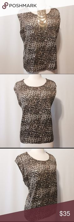 """Ellen Tracey Leopard Print Blouse Scoop neckline, three buttons sleeve detail. Loose fit, silky feel sleeveless blouse. 100% Poly Machine washable 42"""" bust 24"""" overall length Ellen Tracy Tops Blouses"""