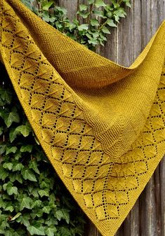 Shawl knitting pattern: Quaking Aspen by Dee O'Keefe. Quaking Aspen is a top-down triangular shawl featuring a richly textured aspen leaf lace border, which appears like a window surrounded by garter stitch. The stitch patterns are intuitive, simple to memorize and relaxing to knit. For lace newbies, Quaking Aspen could even be your first lace shawl. #knitting #knit #knittingpatterns #shawl #shawlpattern #shawlknittingpattern #lace #garterstitch
