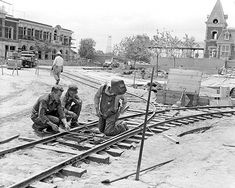 """<div class=""""meta """"><span class=""""caption-text """">Workers lay the foundation of the trolley tracks along Main Street. Horse-drawn streetcars travel on these tracks today, going between Town Square and Sleeping Beauty Castle. (Disneyland Resort/ABC News)</span></div>"""