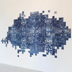 Exhibition: London designers Studio Glithero present an installation of 1000 tiles decorated with photosensitive prints at VIVID Gallery in Rotterdam.