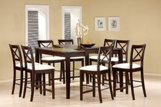 """9 Piece Cappuccino Finish Counter Height Dining Set with Butterfly Leaf By Coaster Furniture by Coaster Home Furnishings. $884.53. dining set furniture. dinning set. square dining set. dining sets. dining table set. Attractive dark walnut finish is one of the highlights of this counter height table, square setting allows for face to face gathering around with your family and friends. Table 36""""h, Seats 24""""h.. Save 55%!"""