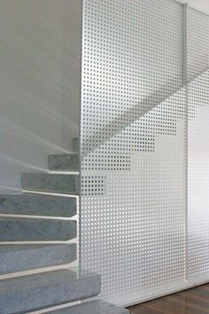 Perforated panels with railing mounted on the stair side of the panel.