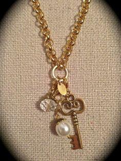 Origami Owl Dangles - custom jewelry creations - gold key  pearl Andie Long, Origami Owl Independent Designer #37040 Order online:  andielong.origamiowl.com Facebook  Http://www.facebook.com/ChooseALocket Email:  ChooseALocket@yahoo.com