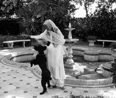 Fatima Jinnah, sister of the founder of Pakistan, Muhamad Ali Jinnah, playing with her dog at her residence in Karachi in 1959.