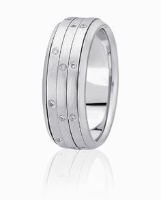 Diamonds Are Flush Set Into Three Bands Of Precious Metal In The Center Of This Fashionable Wedding Ring