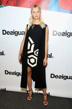 Pin for Later: These Stars Have Been Sitting Pretty in NYFW's Front Row Karolina Kurkova A large white graphic added a little more pizazz to Karolina's all-black Desigual look.