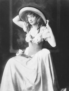 Lillian Gish in a beautiful dress. This was probably around the early 1920's.