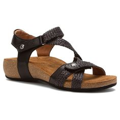 Slip into the chic Taos Trulie casual sandal to add sure comfort for all your warm-weather outings. This women's sandal features a leather upper with woven details for textured appeal; dual adjustable straps allows a perfect fit. The durable rubber sole of the Taos Trulie open-toe sandal ensures reliable traction and lasting wear.