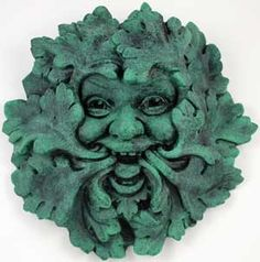 I'm looking for a green man face for my garden. Trouble finding one I find attractive - may have to fabricate my own... This one's ok except it could be larger... and I don't care for the color. Guess I could paint it.....