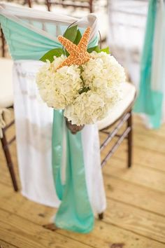 Beautiful chair #decor for a seaside wedding {Black Iris Floral Events}