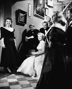 1950 - All About Eve - Bette Davis, Celeste Holm, Ann Baxter, George Sanders, Marilyn Monroe (bit part), etc. All star cast, classic black and white. Brilliant story about The Theatre and all the types of Players involved. Never get sick of seeing it.