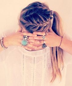 Triple side-French braids pulled into a side ponytail...love the rings too, i wsh i had her hair!! :)) this is a must do:)):):)) ~Yllka