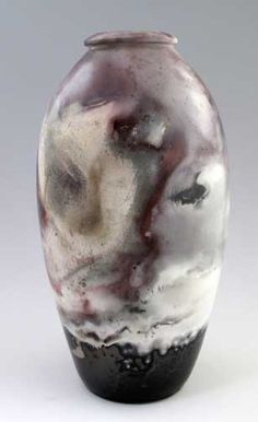 Robert Compton Pottery | Pit fired | The colors on pit fired pottery are not fused in a glaze, and could fade if placed in direct sunlight.