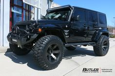 Jeep Wrangler with 20in Fuel Beast Wheels and Toyo Open Country MT Tires