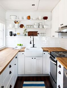 This hits all the points: butcher block counters, farm sink, subway tile, and that flexible faucet.